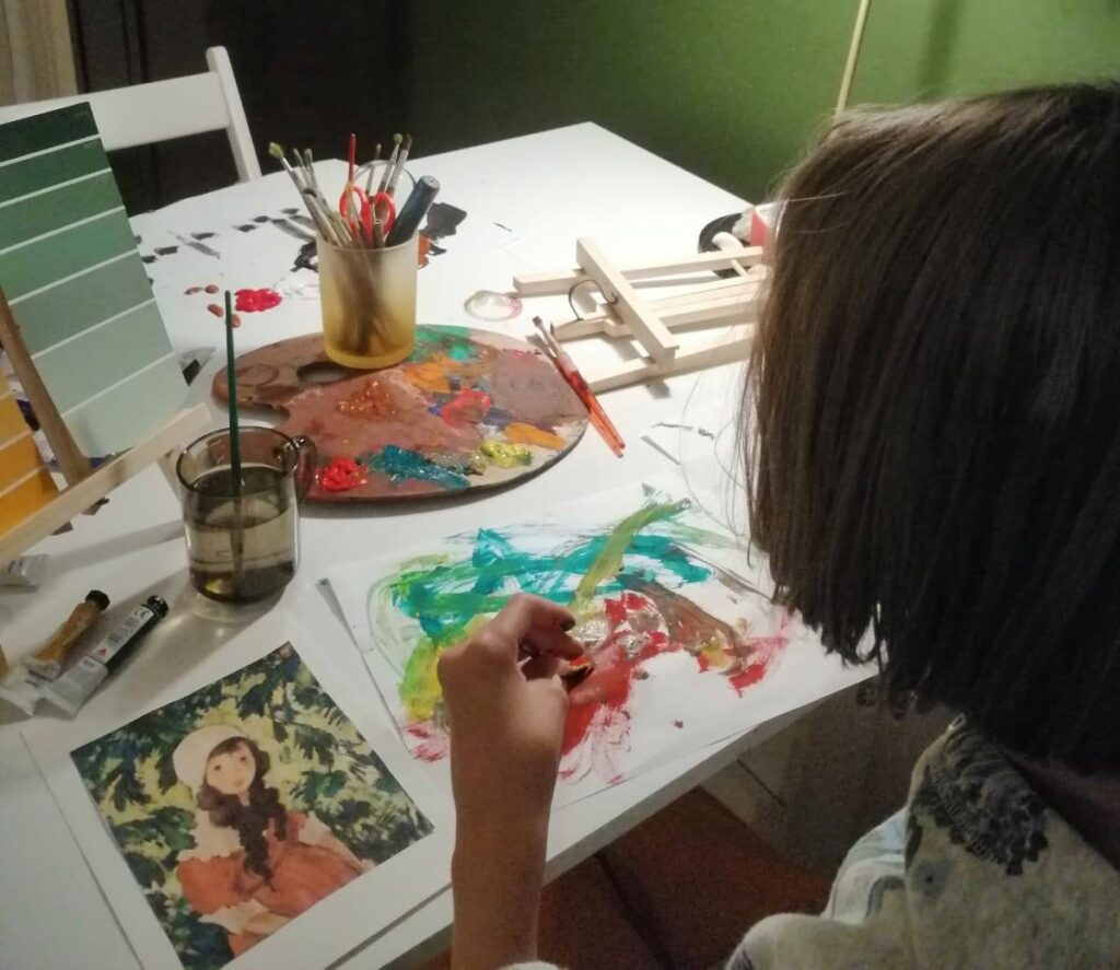 Olga pictând/ foto: Supereroi printre noi